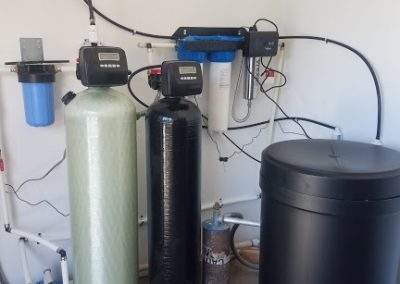 Prefilter, Iron Breaker With Ozone System, 64 K Water Softener, and UV Light Disinfection